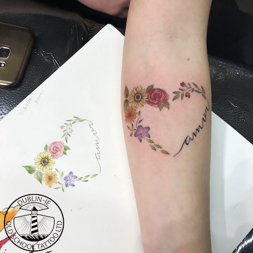 heart of flowers tattoo